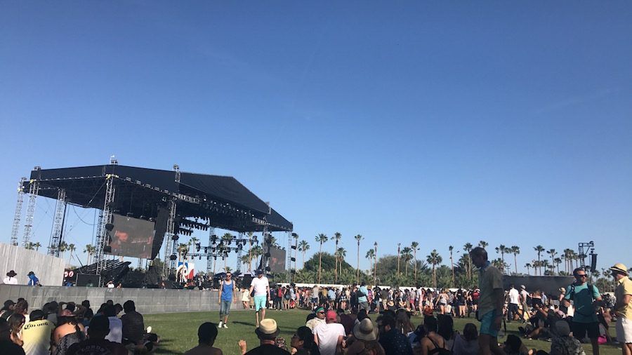 People gather around the Coachella outside stage in anticipation of a performance. Artists performed in front of hundreds of people at the festival.