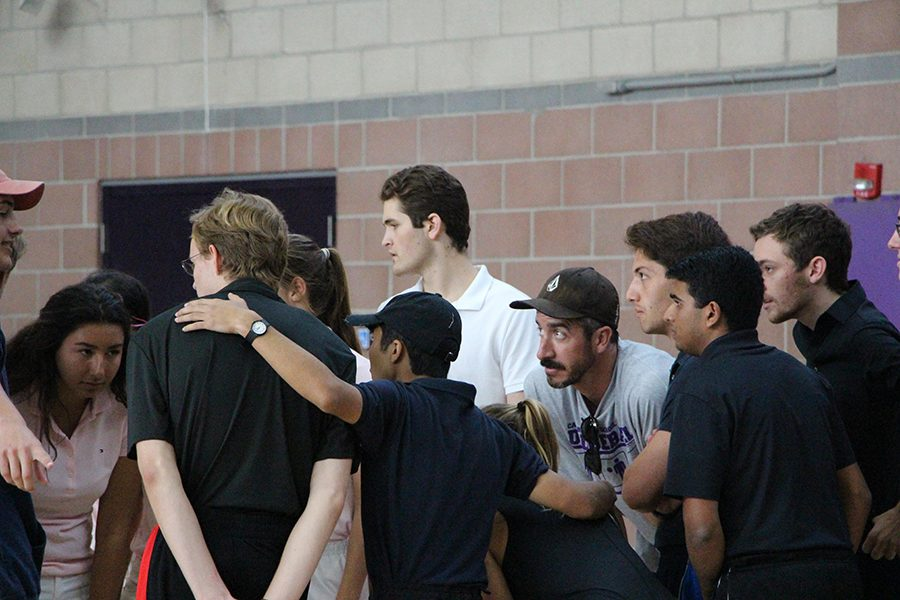 Mr. Tomkinson coacheas seniors Alex De Taboada, Quinn Lozar, Jeffrey Sardina and team as the prepare to meet their opponent.  Teachers not only caoached teams but also formed a few teams of their own to participate in the tournament.