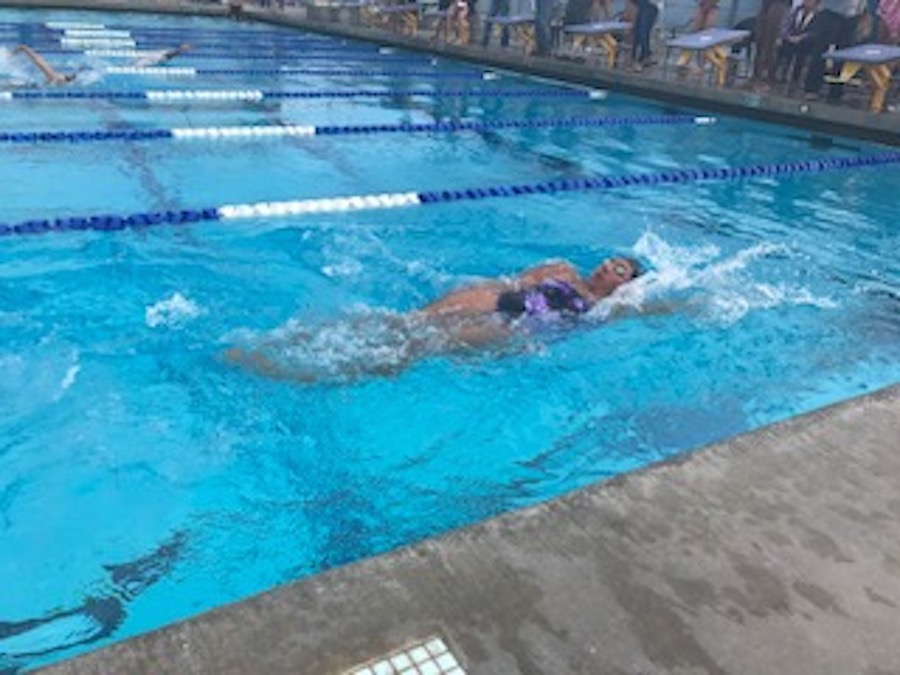 Senior, Melissa Kay, takes on the back stroke at a home meet last week on Tuesday.