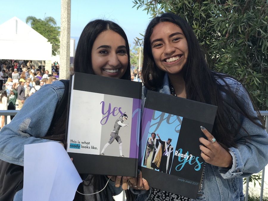 Seniors Sophia Bours and Mariana Jimenez exchange yearbooks to sign each others last high school yearbook