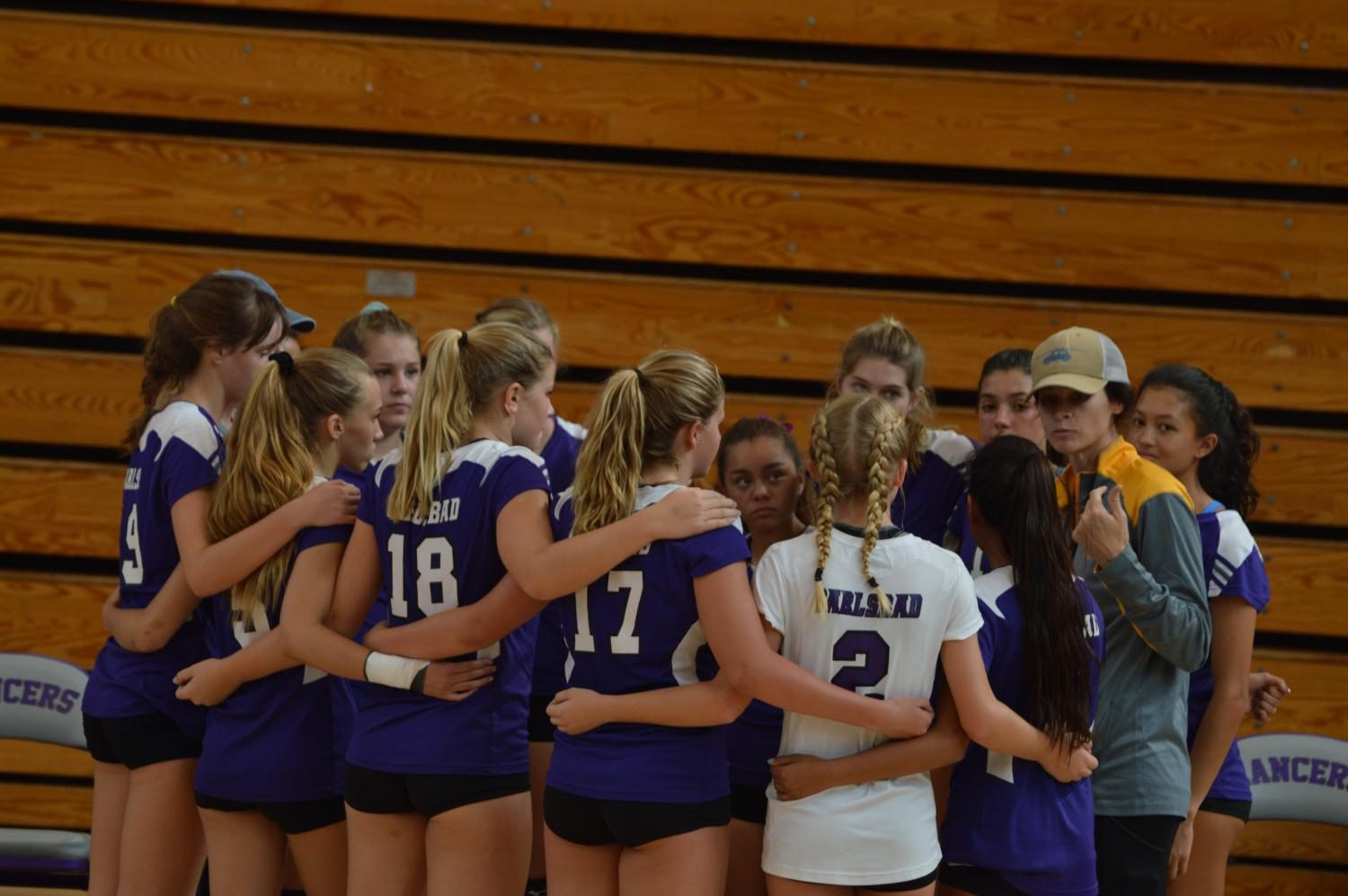 The girls JV volleyball discussing strategy after losing the first set against Rancho Bueno Vista, Tuesday, Sept. 19.