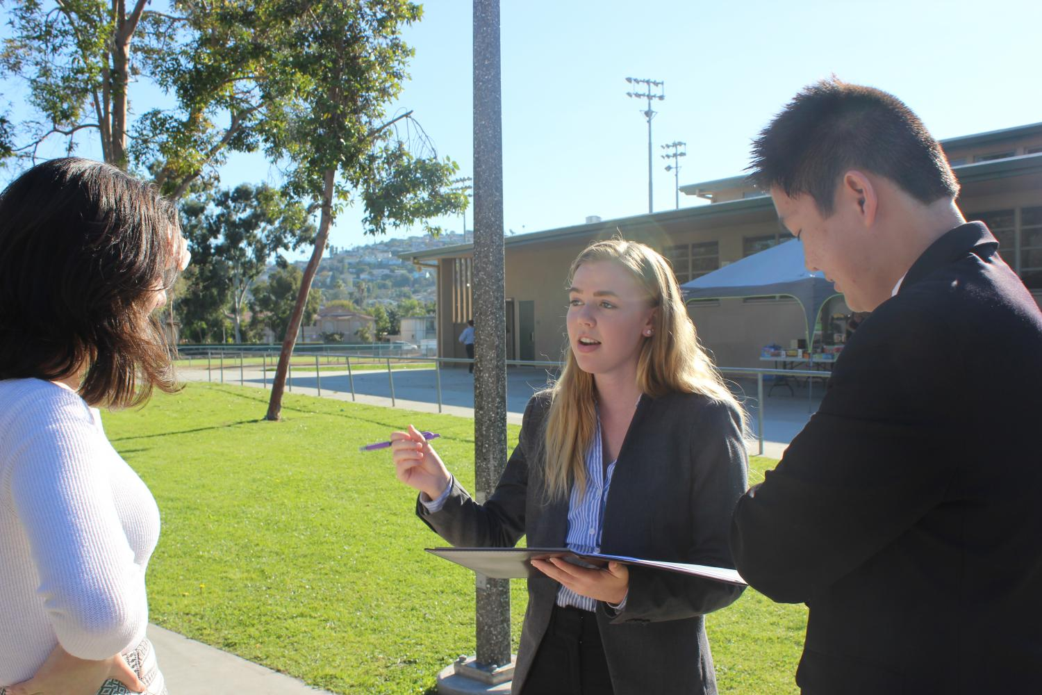 Senior Sarah Morgan practices her speech to Senior Tara Yazdan Panah and Junior Joshua Tran.