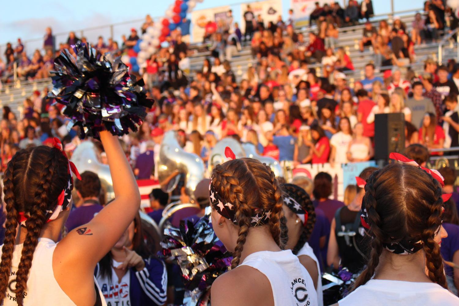 Lancer Dancers look into the crowd as they get ready to perform.
