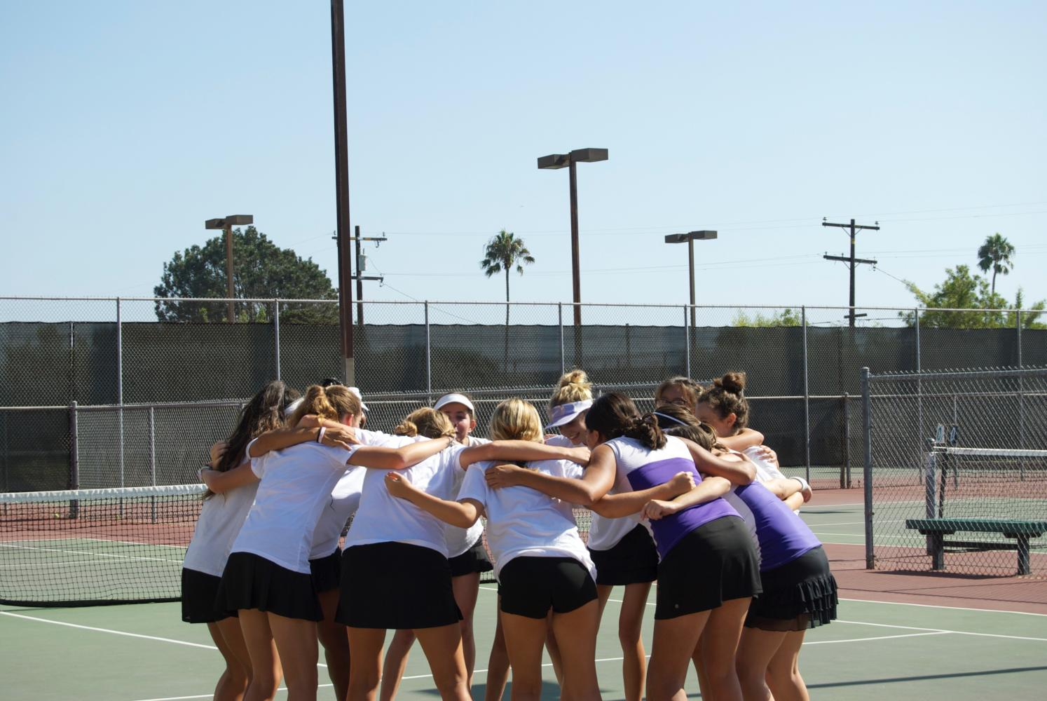 The JV girls' tennis team huddles up during their fall 2017 season.