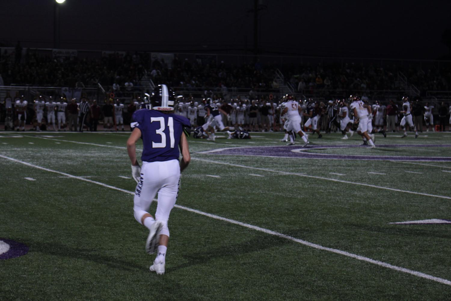 Sophomore, Cole Wright, runs towards the ball during the football game against Mission Hills.