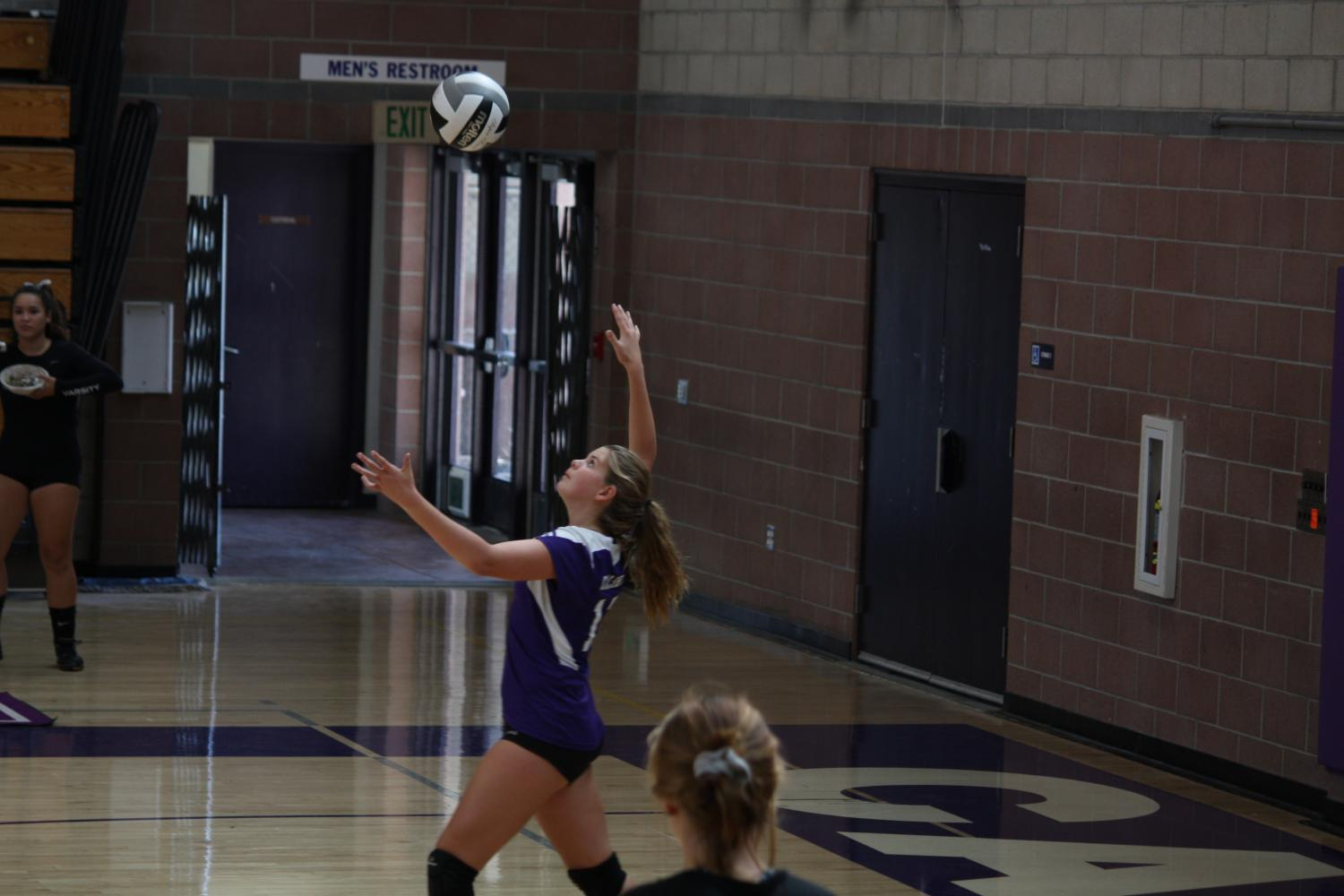 Sophomore Emma Lupica, on girls JV volleyball serves the ball to the Rancho Buena Vista Longhorns who beat JV in two sets, Tuesday, Sept. 19.