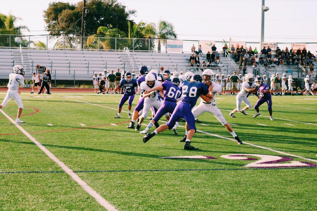 The freshman football team wins 14-9 in a home game against LCC, Thursday, Sept. 21.