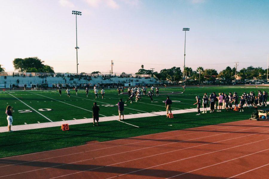JV football players run across the field, Friday, Oct. 13. JV beat San Marcos 21-0.