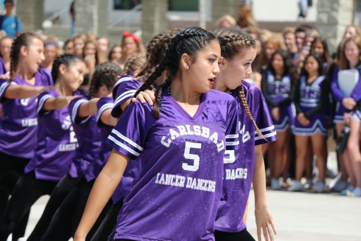 Senior%2C+Maya+Wong%2C+and+sophomore%2C+Nicole+Burke%2C+dance+during+the+USA+game+pep+rally%2C+Friday%2C+Sept.++15.+The+Lancer+Dancers+work+to+hype+up+students+for+the+game+during+the+pep+rally.