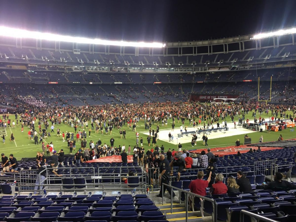 At+the+SDSU+stadium%2C+everyone+runs+onto+the+field+to+celebrate.+The+Aztecs+beat+Stanford+20-17+on+Sept.+16.++