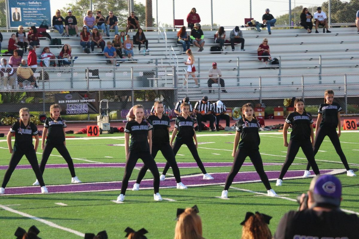 X-Calibur+starts+out+their+halftime+dance+during+the+JV+football%2C+Friday%2C+Sept.+15.+The+dancers+work+to+excite+the+crowd+for+the+second+half+of+the+game.