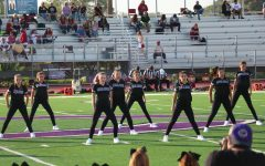 X-Calibur starts out their halftime dance during the JV football, Friday, Sept. 15. The dancers work to excite the crowd for the second half of the game.