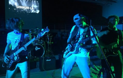 Sophomores Jake Watts, Foster Provo and Mitch Schreibman, perform in their band, Shangri-la, for Break the Chain Battle of the Bands, Saturday, Oct. 7. The Battle of the Bands competition was held at San Dieguito Academy to raise money to end human trafficking.