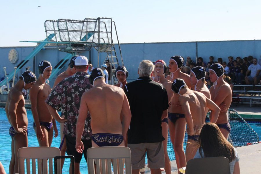 Carlsbad varsity water polo plays Bishops on Tuesday, October 10th.  Coach Feaster, goes over what the team needs  to improve on in the second half.