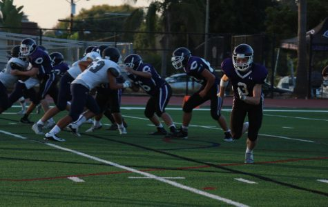Sophomore, North Dewhurst, runs across the field. The JV football team was successful in beating the San Marcos team.