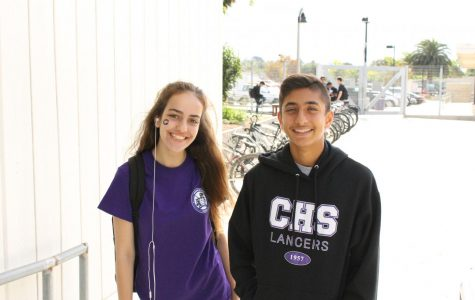 Junior Sierra Vakilli, and freshman Ravi Pathak, smile for the camera. The students exhibit confidence with their proud smiles and school spirit.