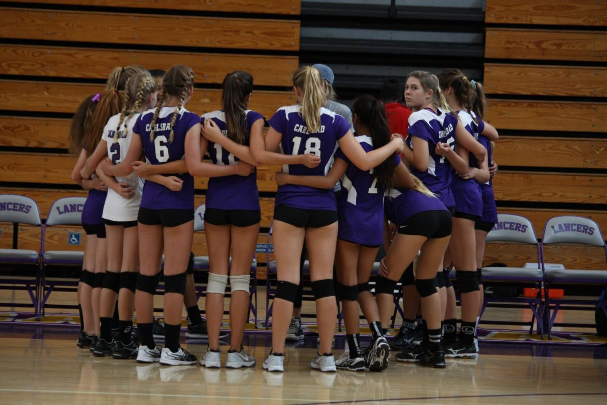 A Lancer alumn, Cassie Belk, is the new girls JV Volleyball coach at Carlsbad High School. At the game Tuesday, Sept. 19, Coach Belk gave the girls a pre-game pep talk. The Lancers played the Rancho Buena Vista Longhorns and lost 0-2.