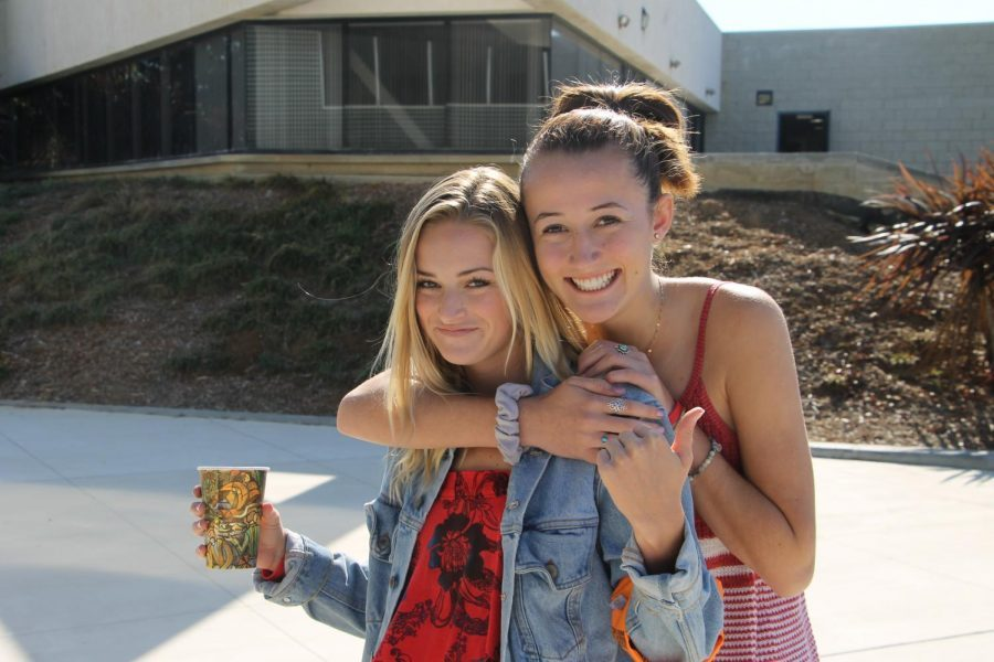Seniors Kira Manuel and Peyton Headlee smile to celebrate Red Ribbon Week. ASB encourages every student to wear red for  their school spirit during Red Ribbon Week.