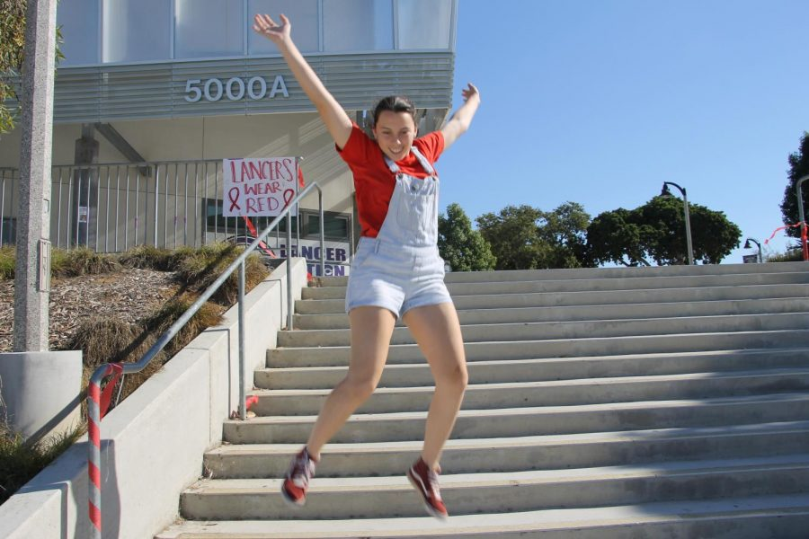 Junior Camryn Riccitelli jumps in joy to celebrate red ribbon week. On the week of 10-23 through 10-27, students were encouraged to wear red to show their school spirit.