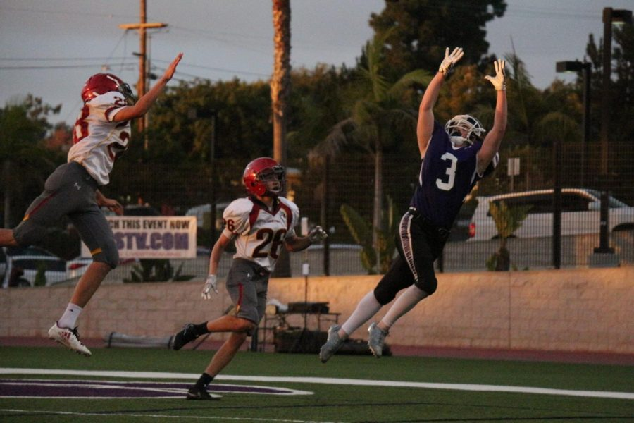 Sophomore+North+Dewhurst+prepares+to+catch+a+pass+during+the+JV+football+game%2C+Friday%2C+Oct.+20.+JV+football+played+Torrey+Pines+and+lost+14-20.%0A%0A