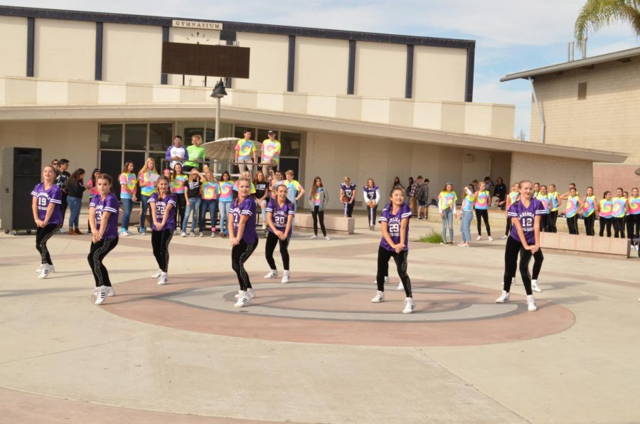 Seniors Maya Wong and Rachel Whitehead(left to right) performs their last pep rally for this home game. They practiced every minutes to perform their best moves for the pep rallies and Halftime Show.