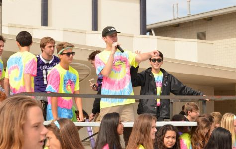 Senior Korey Loberg takes the mic during the neon game pep rally. The ASB hosts every pep rally to encourage students to go to the football game.