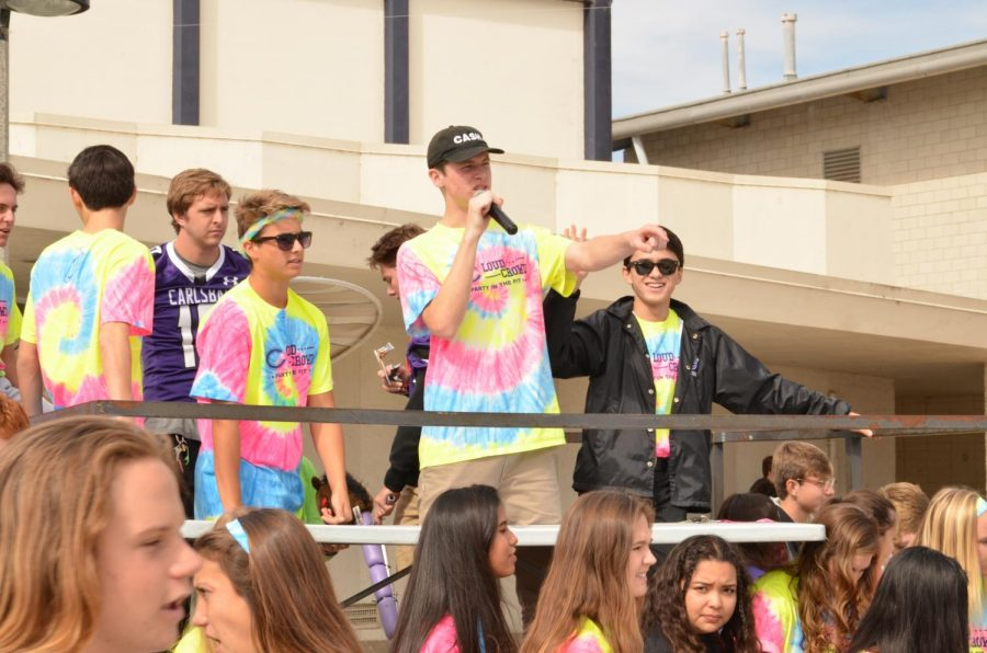 Senior+Korey+Loberg+takes+the+mic+during+the+neon+game+pep+rally.+The+ASB+hosts+every+pep+rally+to+encourage+students+to+go+to+the+football+game.