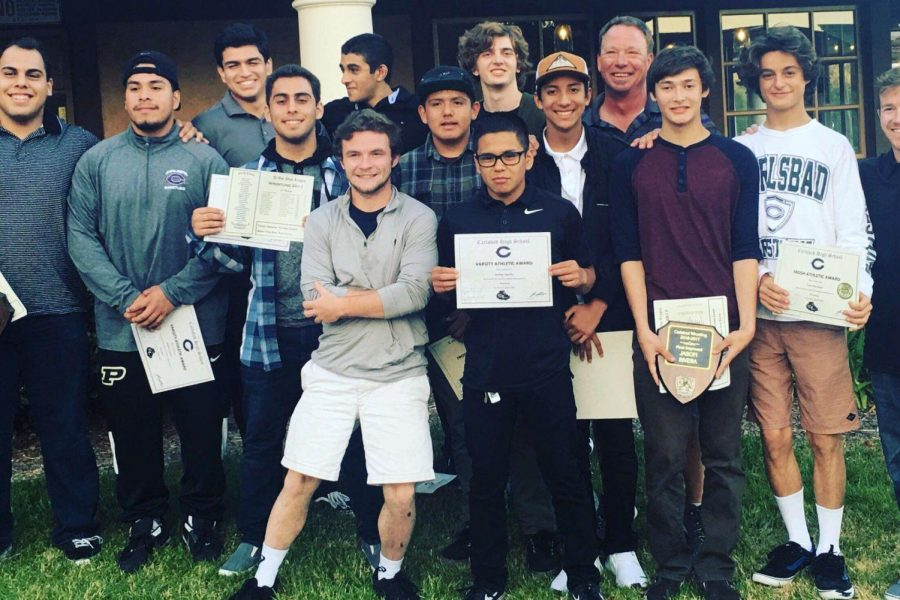 The+2016-17+wrestling+team+gather+for+a+team+photo.+The+end+of+the+wrestling+season+was+commemorated+with+a+banquet+for+the+team+members.