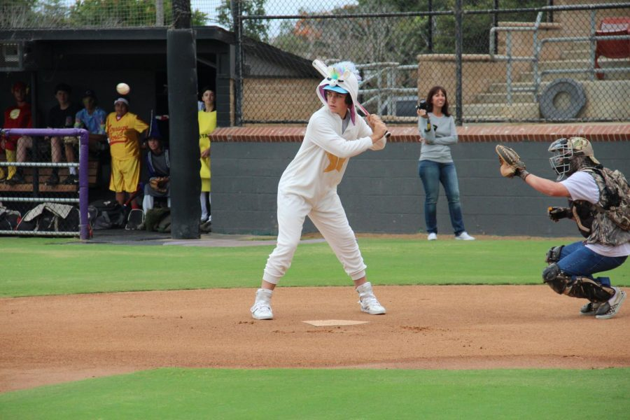 Junior Trent Lopez with is eye on the ball. Trent wore a unicorn costume for the baseball Halloween Scrimmage.