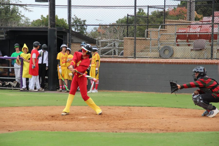 Sophomore Justin Larimer at bat in his Halloween Flash costume. Every year the students of baseball P.E. participate in a costume baseball scrimmage.
