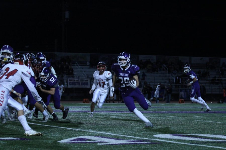 Sophomore Noah Vella looks for openings as he runs the ball up the field. Vella plays for varsity football, who beat Vista 48-14 on Friday, Nov. 3.