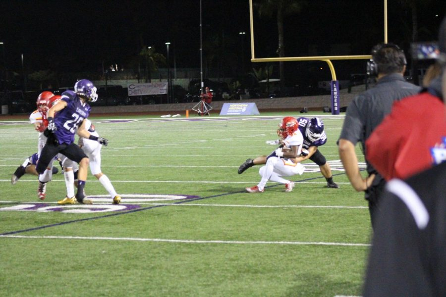 Cathedral goes for another run up the sideline hoping to gain yardage and stop the clock. Senior Cole James is able to read the play and make the tackle before the line of scrimmage.