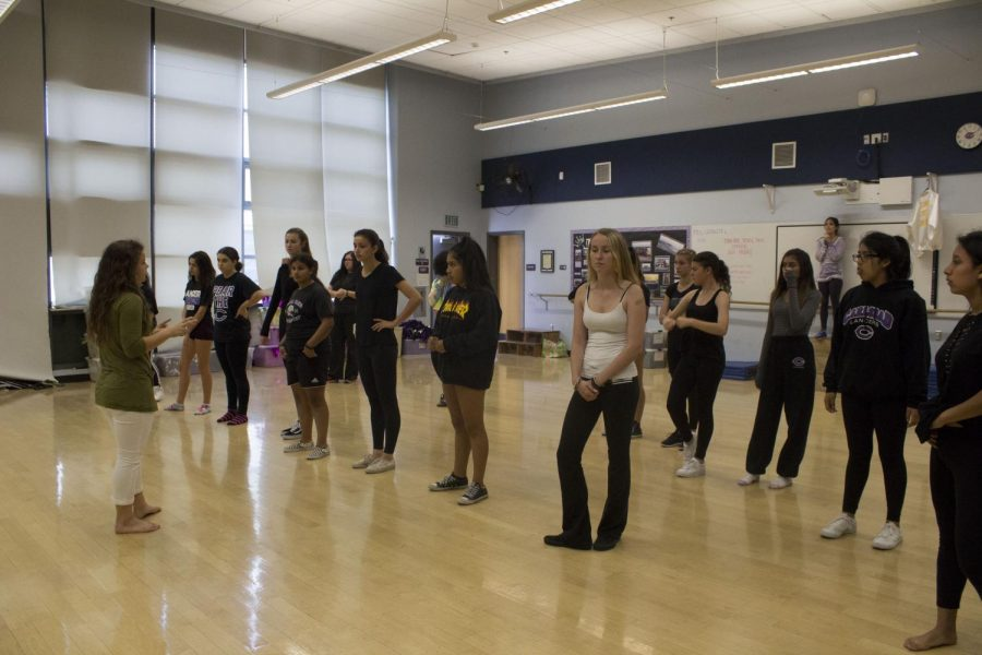 Dance teacher Mrs. Clawson teaches the students different dance routines. The dancers prepare for their upcoming winter showcase.