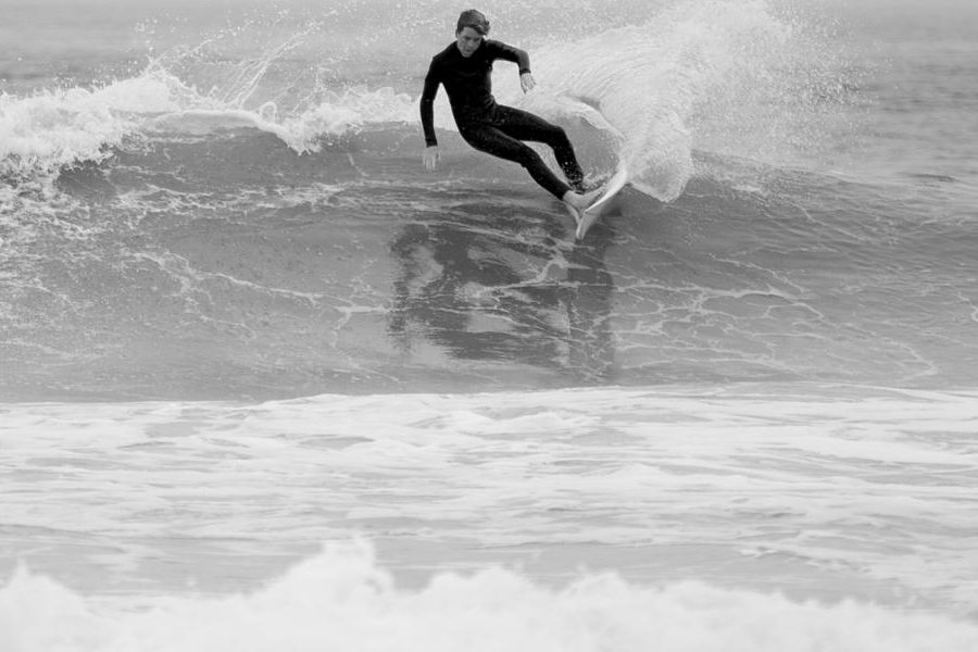 Junior Tyler Nash begins his cutback at local surf spot, Dip in the Road. Nash competes on the surf team.