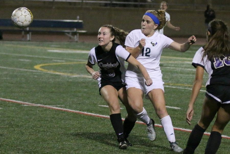 Senior Mia Spano fights for possession of the ball. Spano is a member of the womens varsity soccer team.