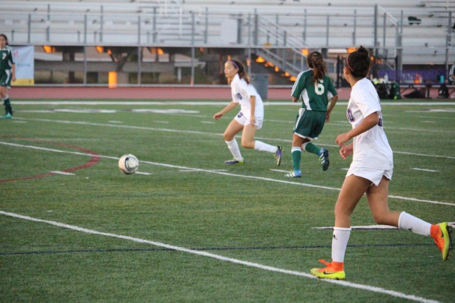 Freshman Natalia Avalos follows her team-mate, trying to stay open. Carlsbad High Schools freshman girls soccer team lost 1-0 to San Marcos.