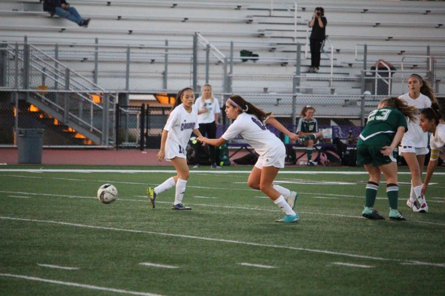 Isabella Vega looks for her target as she approaches the soccer ball. Carlsbad High Schools freshman soccer team played against Poway High School at home.