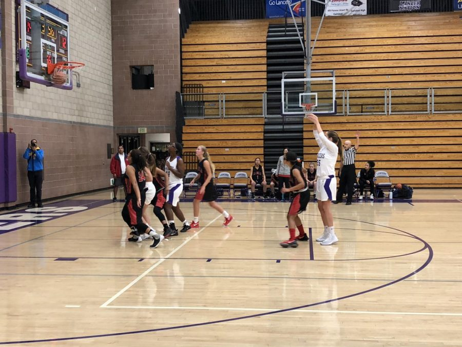 Senior Arianna Pagan shoots the ball into the hoop. As a foul was called on the court, she was then able to take a free throw and make a basket.