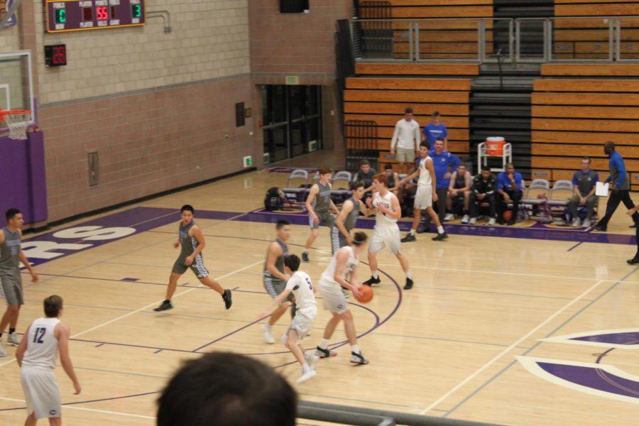 Junior Gavin schmidt loos for an open team mate he can pass the ball to. The opposing team guards Schmidt so he can not make a pass.