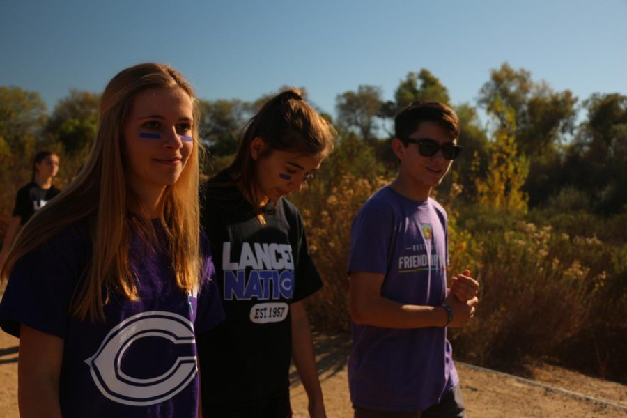 Senior Max Ward and juniors Nicole Less and Nevina Rocco begin their walk, Saturday, Dec. 2. Members of the best buddies club participated in the second annual San Diego Best Buddies Friendship Walk at Kit Carson Park.