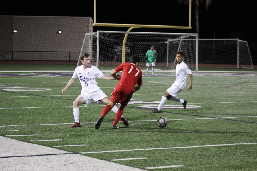 Senior Luke Mino steals the ball away from opposing player. Carlsbad defeats Sweetwater 5-1.
