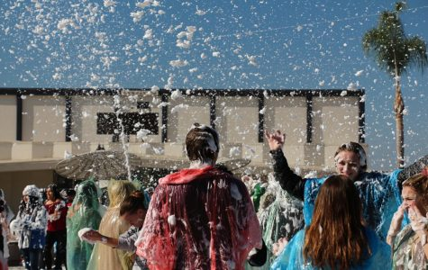 Foam is sprayed over students. Blizzard 3.0 took place on Thursday, Dec. 14, at lunch in the quad.