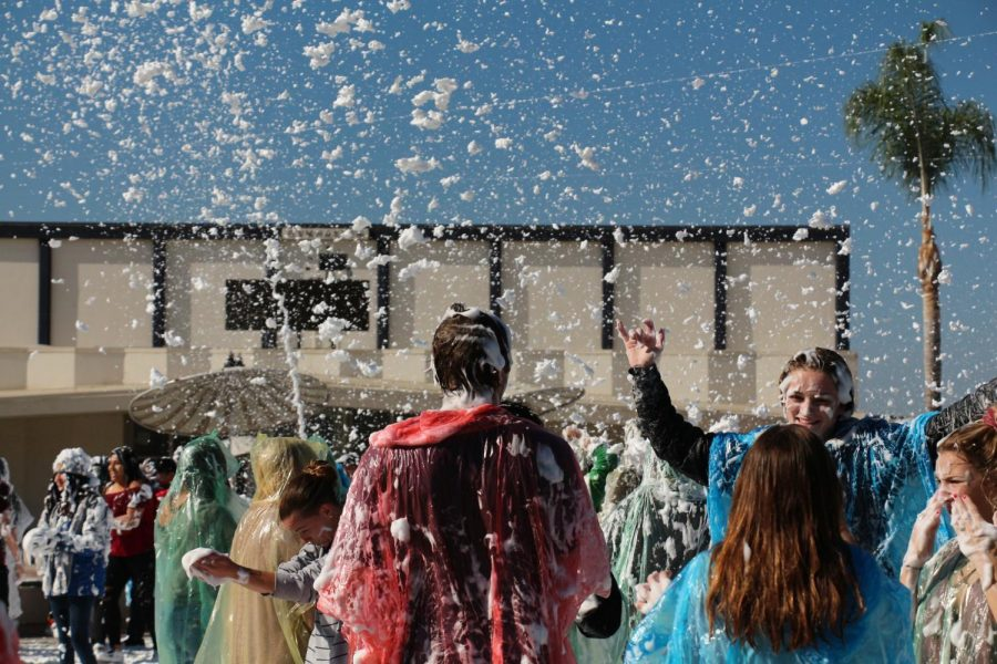 Foam+is+sprayed+over+students.+Blizzard+3.0+took+place+on+Thursday%2C+Dec.+14%2C+at+lunch+in+the+quad.