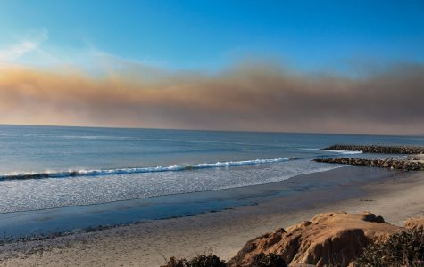 The Lilac Fire is visible over the Carlsbad coast. The Lilac Fire originated in Bonsall and began spreading towards the Oceanside coast.