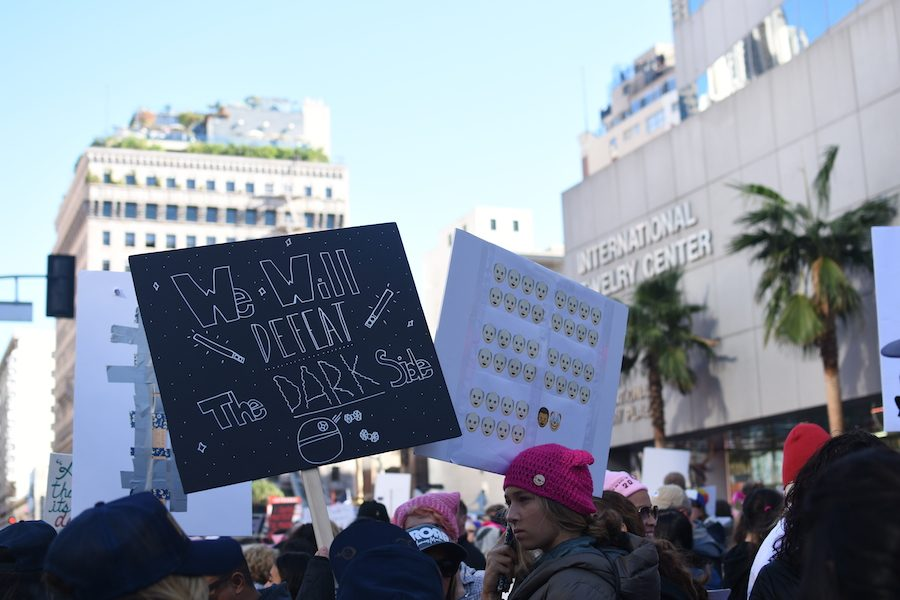 People Women's March LA 2018 get creative with sign building and messages during protest. 500,000 women marched on January 20th making it the largest march of the year.