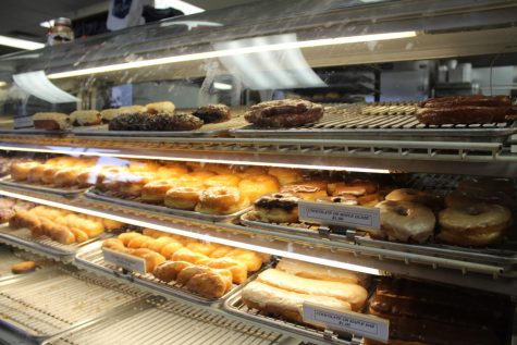 All the available donuts can be seen on the display rack. The donuts can be purchased for a low price of $1.