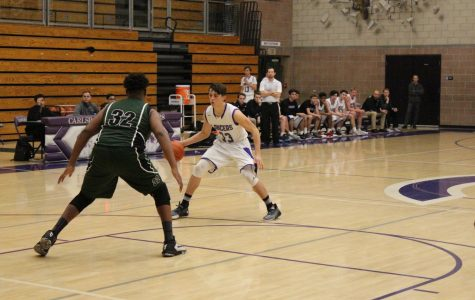 Sophomore Kyle Vassau dribbles the ball. This is Vassau's first year on the JV basketball team.