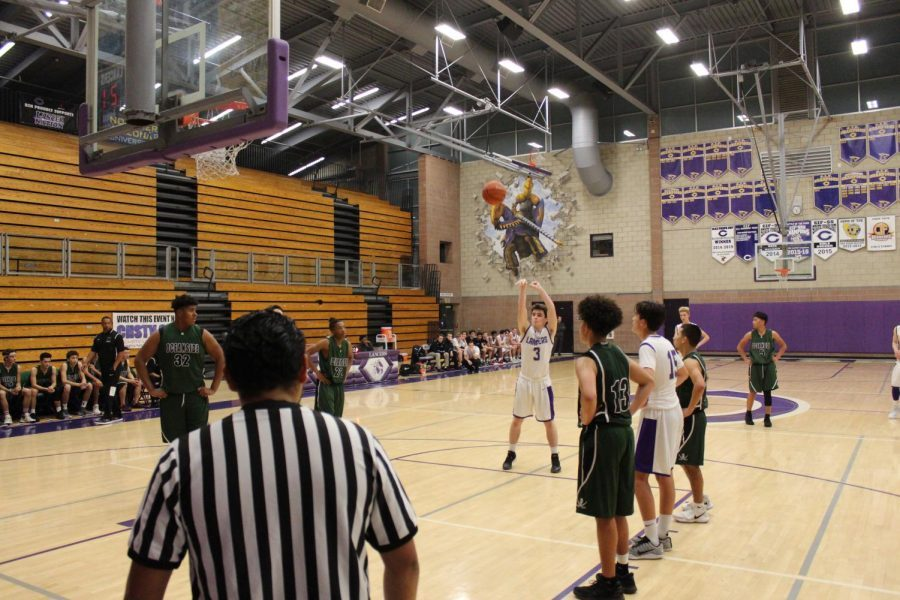 Sophomore North Dewhurst shoots a free throw. Dewhurst was on the freshman basketball team last year.