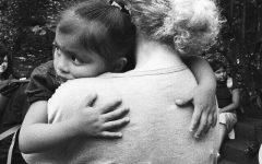 Junior Kaylin Kolb hugs a little girl from Nicaragua.