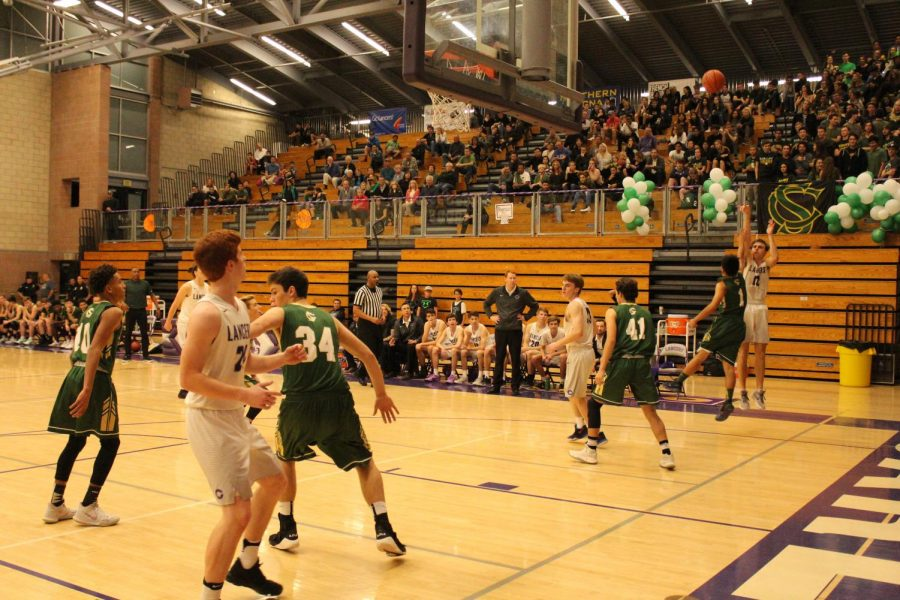 Senior Isiah Ramos jumps in the air for a huge three point shot. This was able to make the Lacers tied with Sage Creek.